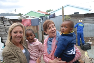 Diane Brice, of FACE, with children at the pre-school.