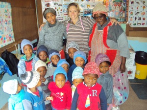 Sophie distributes hats at Sibabalwe